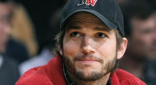 Ashton Kutcher sits courtside during the Los Angeles Lakers against Denver Nuggets NBA playoff game in Los Angeles