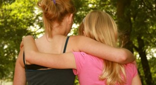 teen GIRLS hugging