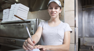 Take out order waitress in a fast food restaurant