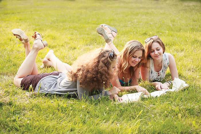 COLLEGE GIRLS  students-reading-in-grass