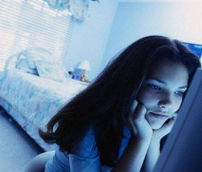 Teenager Using Computer in Bedroom --- Image by   L. Clarke/CORBIS