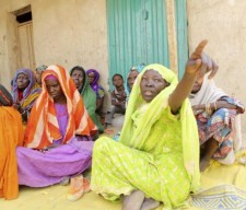 Women who survived Boko Haram occupation sit on the ground in Damasak