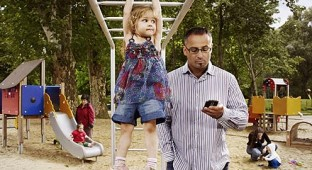 DAD ON CELL W CHILD