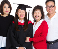 Happy family gathered together with graduate student