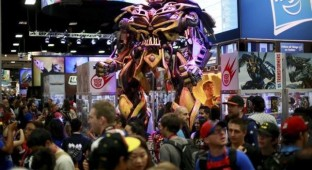 A Transformers statue stands on display at the Hasbro booth during the 2014 Comic-Con International Convention in San Diego