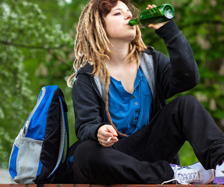 Girl playing hookey and drinking alcohol