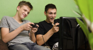 Kids playing video game in their room