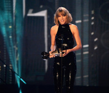 iheartradio-awards-Taylor-accects-award-04-2016-billboard-650