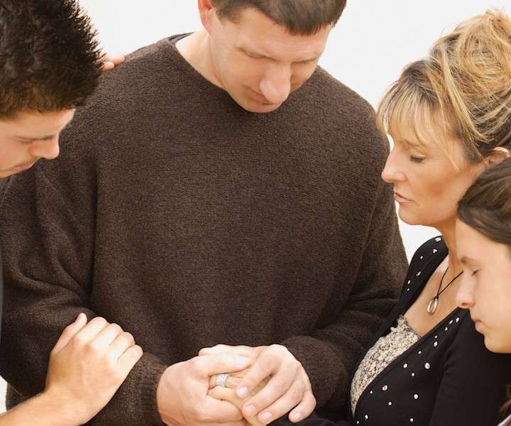 Family Praying parents mom dad