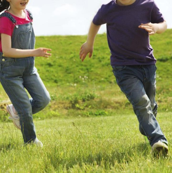 happy-boy-girl-running-outdoors