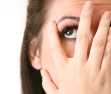 blind-embarrassed-women-hands-hiding-her-face-eyes-peeking-out