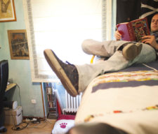 Pablo Vega, a former video-game tester for Electronic Arts Inc. who is forced to live at home because of his job situation, reads a book in his bedroom in Madrid, Spain, on Monday, May 28, 2012. More than half of all workers under age 24 are jobless and 37 percent of Spaniards between 18 and 34 live with their parents. Photographer: Angel Navarrete/Bloomberg *** Local Caption *** Pablo Vega Gonzalez