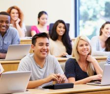 Students Using Laptops And Digital Tablets In Lecture