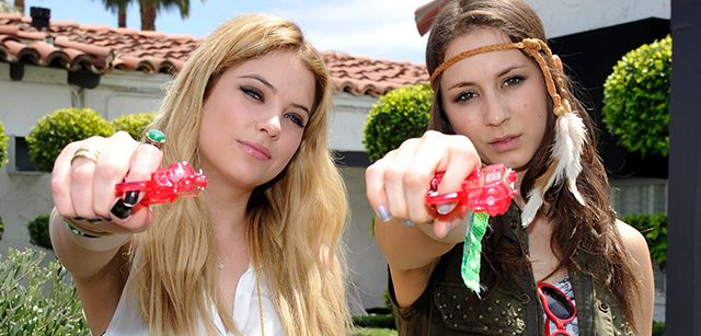 PALM SPRINGS, CA - APRIL 13:  Ashley Benson and Troian Bellisario attend the GUESS Hotel pool party at Viceroy Palm Springs on April 13, 2013 in Palm Springs, California.  (Photo by John Sciulli/Getty Images for GUESS)