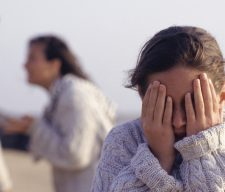 Couple arguing, girl parents sad