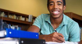 Black teenager studying school smile