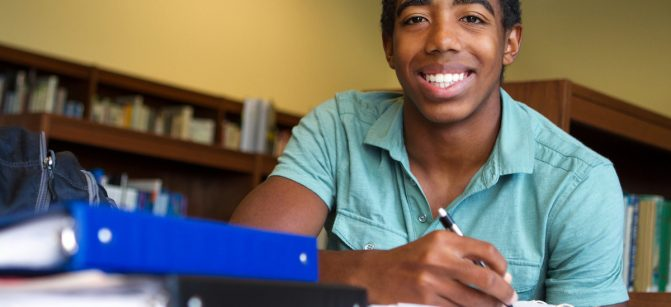 Black teenager studying school smile