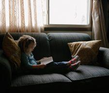 Bible kid read sad