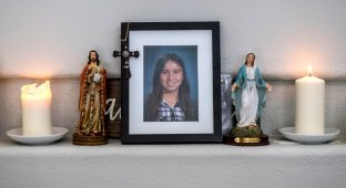 With candles lit, a photograph Emma Pangelinan sits on the mantle in the living room of her home in Mission Viejo on Friday, March 16, 2018. Emma, who at 13 years old, killed herself in January.  (Photo by Mark Rightmire, Orange County Register/SCNG)