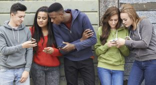 Group Of Teenagers phones cell