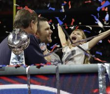 New England Patriots' Tom Brady holds his daughter Vivian, after the NFL Super Bowl 53 football game against the Los Angeles Rams, Sunday, Feb. 3, 2019, in Atlanta. The Patriots won 13-3. (AP Photo/Carolyn Kaster) ORG XMIT: NFL