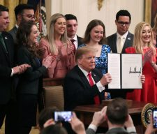 WASHINGTON, DC - MARCH 21: U.S. President Donald Trump holds up an executive order he signed protecting freedom of speech on college campuses during a ceremony in the East Room at the White House March 21, 2019 in Washington, DC. Surrounded by student who have said their conservative views are suppressed at universities across the country, Trump signed the order 'improving free inquiry, transparency, and accountability on campus,' according to the White House. (Photo by Chip Somodevilla/Getty Images)
