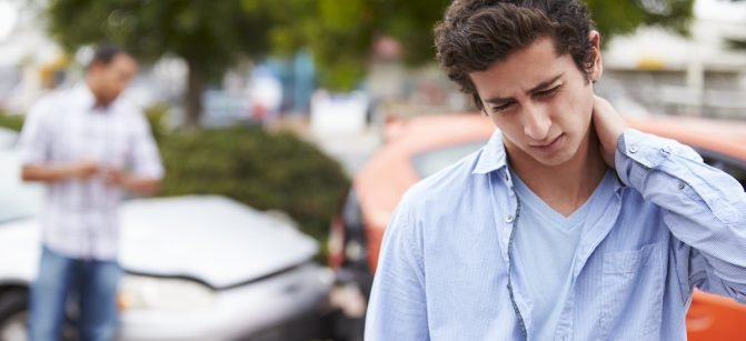 Teenage Driver Suffering Whiplash Injury Traffic Accident car