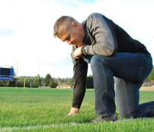 Praying coach football