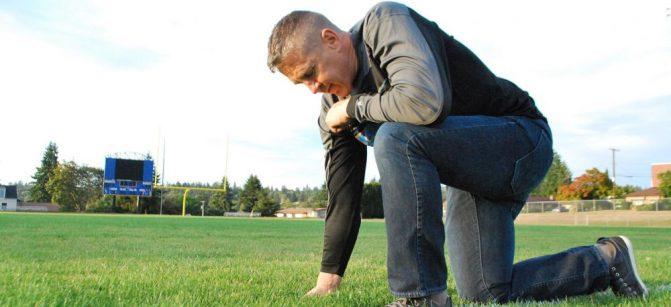Praying coach football
